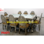 Finely Carved Silver Dining Table and Chairs